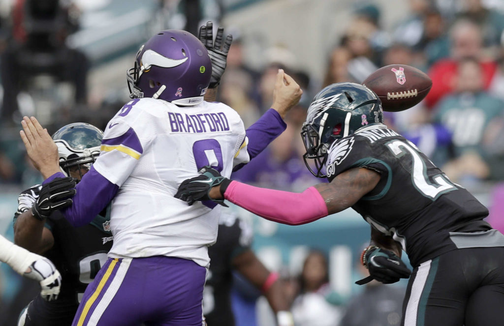 Eagles' free safety Rodney McLeod forces a fumble against Minnesota Vikings' quarterback Sam Bradford during the second-quarter on Sunday, October 23, 2016 in Philadelphia.  YONG KIM / Staff Photographer
